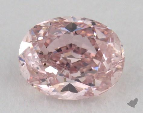 0.68 Carat fancy pink Oval Cut Diamond