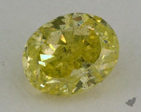 0.76 Carat fancy intense greenish yellow Oval Cut Diamond