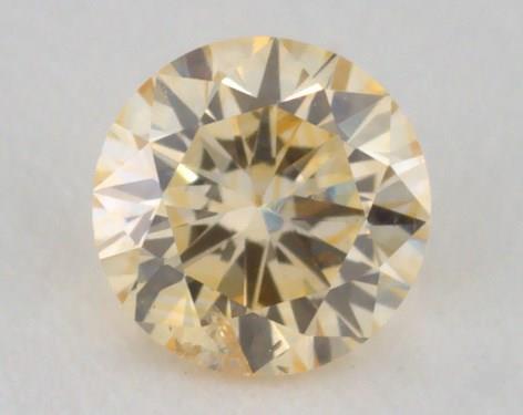 0.22 Carat fancy orangy yellow-I1 Round Cut Diamond