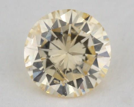 0.32 Carat fancy light orangy yellow-I1 Round Cut  Diamond