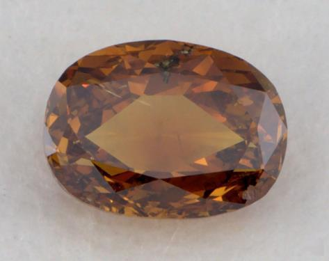 0.67 Carat fancy deep brownish yellowish orange-I1 Oval Cut Diamond