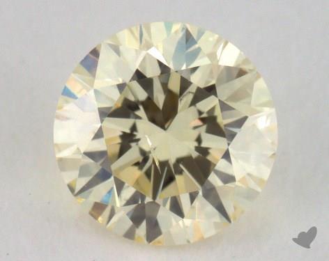 0.70 Carat light yellow-SI2 Round Cut Diamond