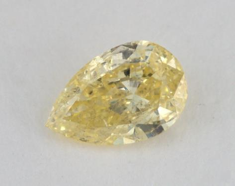 0.68 Carat fancy intense yellow-I1 Pear Shape Diamond