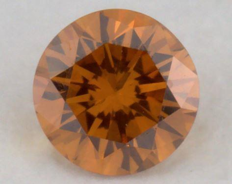 0.20 Carat fancy deep yellowish orange-SI1 Round Cut Diamond