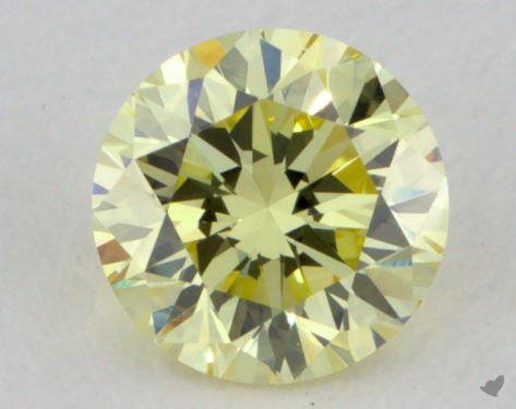 0.52 Carat fancy yellow Round Cut Diamond