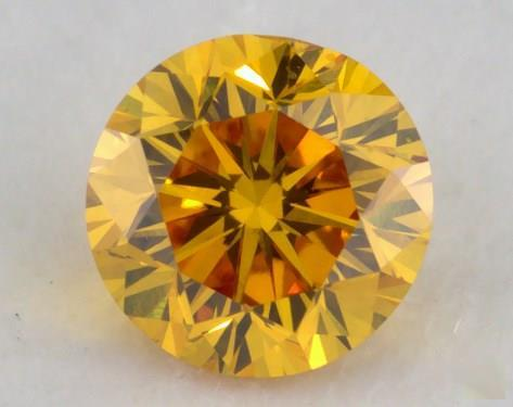 0.31 Carat fancy vivid orangy yellow-SI2 Round Cut Diamond