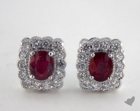 18K White Gold Diamond Framed 0.80tcw Oval Ruby Earrings.