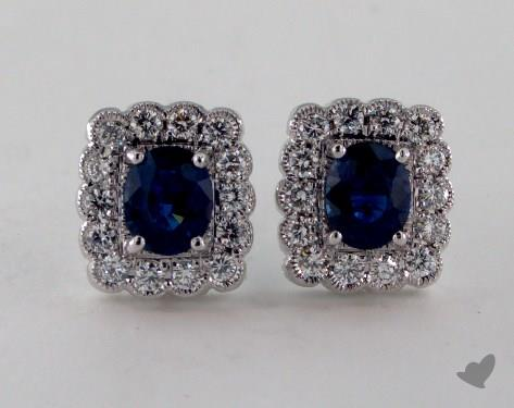 18K White Gold Diamond Framed 0.95tcw Oval  Blue Sapphire Earrings.