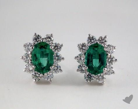 18K White Gold Starburst 0.85tcw Oval Green Emerald and Diamond Earrings.